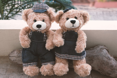 soul mate: two teddy bears on wood background vintage style, concept love