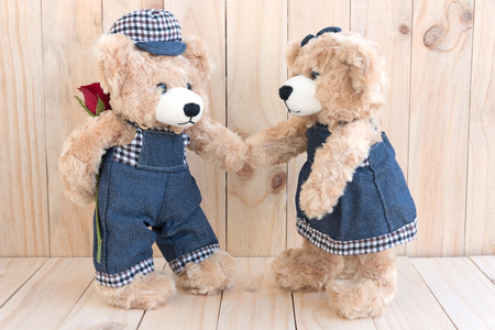 soul mate: two teddy bears with rose on wood background, love concept for valentines day, wedding and anniversary Stock Photo