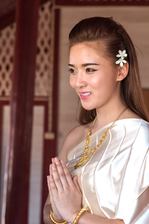 attire: Thai lady in vintage original thailand attire, welcome in thailand style (sawasdee) Stock Photo