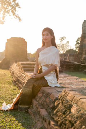 attire: Thai lady in vintage original thailand attire, waiting for something