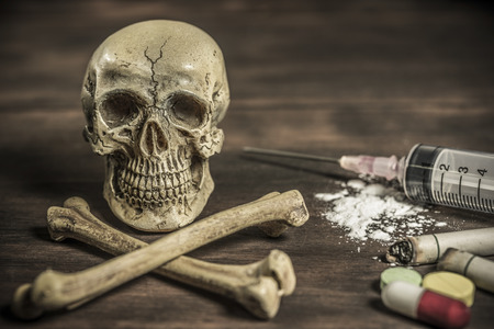 intoxicate: Human skull and crossbones with drug addict, healthcare and medical drugs addition concept