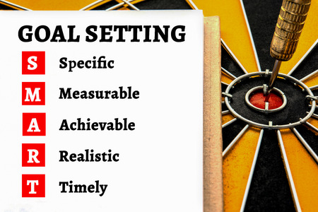 measurable: Words goal setting and smart with dart target arrow on the center of dartboard, Smart goal target success business investment financial strategy concept, abstract background