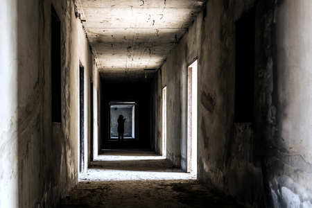 Abandoned building ghost living place with scary woman inside, darkness horror and halloween background concept Stock Photo