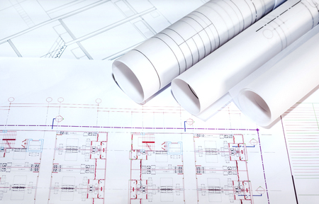 architect tools: blueprints paper and blueprints rolls, the past of architectural project, construction and renovation concept