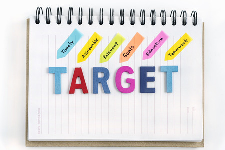 achievable: Words target on the notebook with handwriting timely achievable relevant goals education teamwork over white background, Business success concept