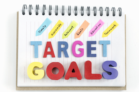 achievable: Words goals target and handwriting timely achievable  relevant goals education teamwork on notebook over white background, business success concept