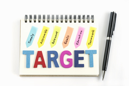 achievable: Words target on the notebook with handwriting timely achievable relevant goals education teamwork and pen over white background, Business success concept
