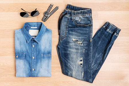 Fashion men and accessories new trendy blue jeans, Top view