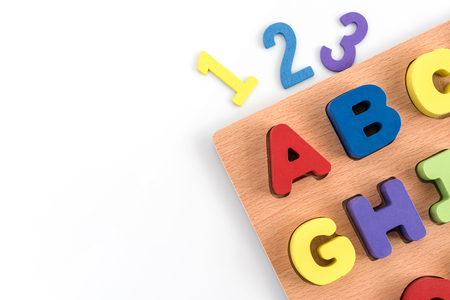 Colorful wood alphabet letters and number (1 2 3) isolated on white paper background with copy space include clipping path for design work, Education kids concept Stock Photo