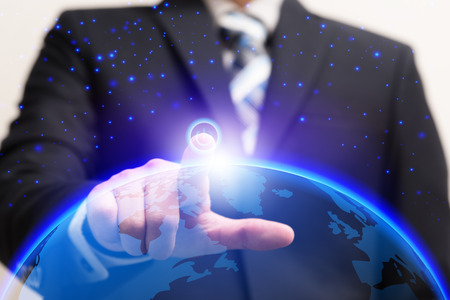 Businessman turn on power switch to connect global connection with digital planet, Future technologies concept