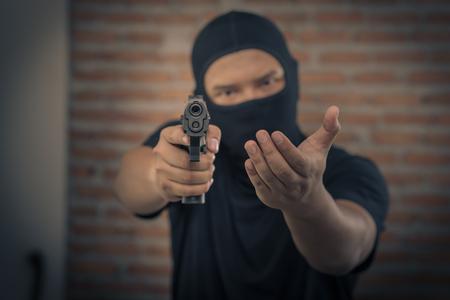 heist: Thief pointing a gun, Terrorism concept