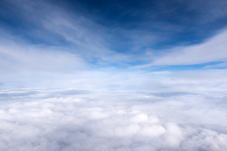 Blue sky with clouds and skyline aerial view from airplane, cloudscape landscape Stock Photo