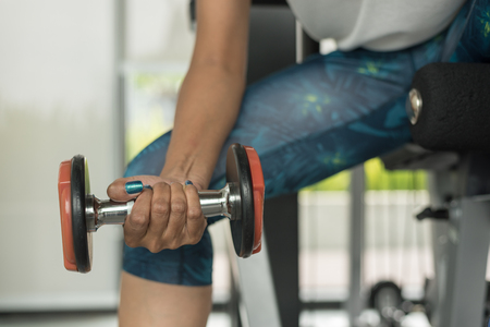 Sport fitness woman doing exercise with dumbbells Stock Photo