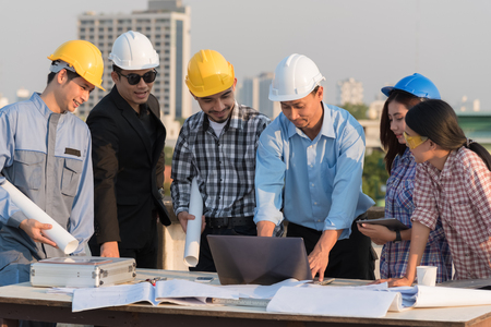 Group of engineers and architects discuss at a construction site, Architecture and Engineering concept Standard-Bild