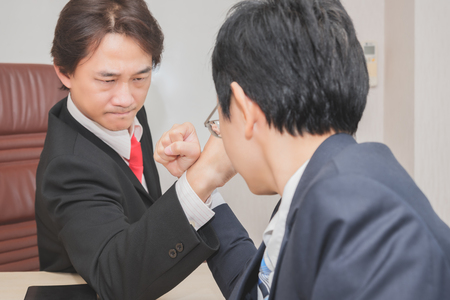 Two Businessman Competing In Arm Wrestling, Competition concept