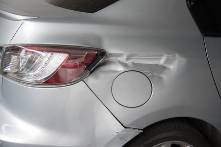 Silver car get damaged by accident on the road