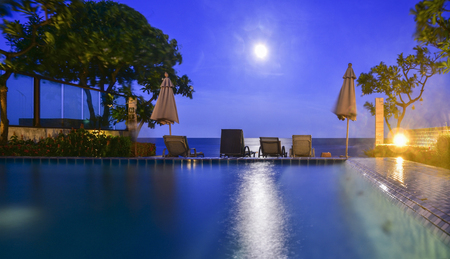 Sea view and the moon in the night and the beach in Thailand