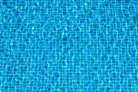 Abstract background of sparkling cool blue water in a swimming pool