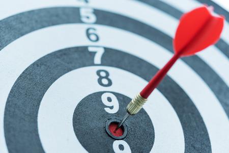 Red dart target arrow hitting on bullseye, Metaphor to target marketing and business success concept Stock Photo