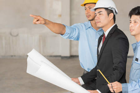 Group of engineers and architects discuss at a construction site, Architecture and Engineering concept, Renovation conceptual
