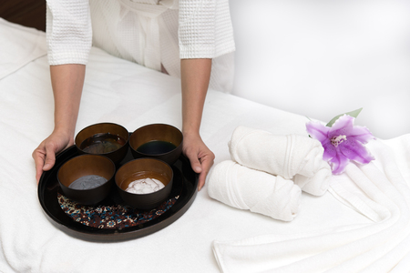 Hands of happy woman holding spa facial face mask in spa salon background, Healthy lifestyle and relaxation concept