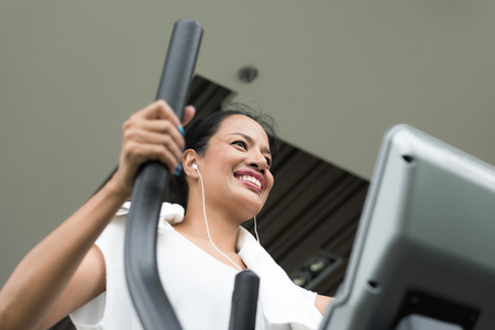 Woman exercising and working out in fitness gym, Sport activity Stock Photo