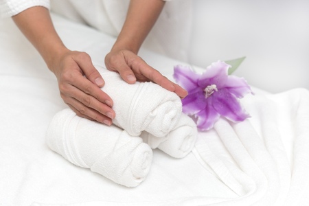 Hands of happy woman setting spa or wellness welcome decoration in spa salon background, Healthy lifestyle and relaxation concept