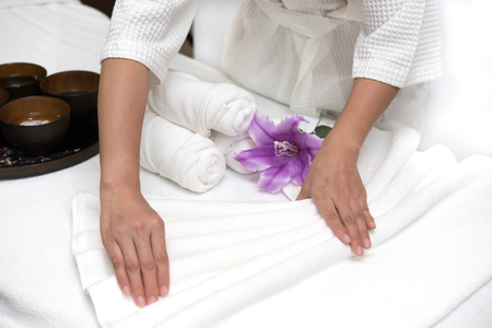 Hands of happy woman setting spa or wellness welcome decoration in spa salon center, Healthy lifestyle and relaxation concept
