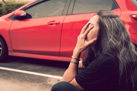 Unemployment woman and gray hair with worried stressed face expression at car park