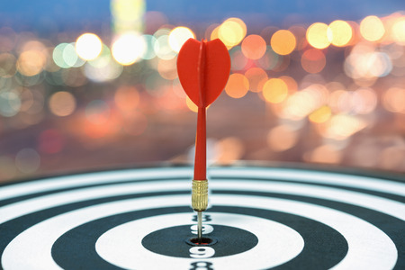 Red dart target arrow hitting on bullseye over blurred bokeh light background, Metaphor to accuracy in business success concept, Marketing conceptual