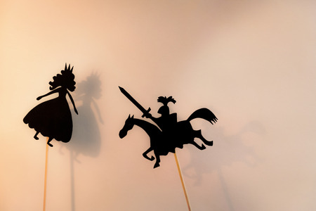 puppets: Two shadow puppets, copy space background. Stock Photo