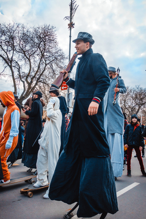 stilts: Varna, Bulgaria, March 26, 2016: Group of participants of the annual Spring Carnival marching on stilts.