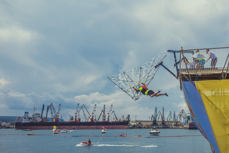 judged: Varna, Bulgaria - Jule 02, 2016: Red Bull Flugtag 2016 competition was held in the sea port of Varna. During Flug Tag event competitors attempt to fly off a pier into the sea their home-made human-powered flying machines. Competition are judged in three c