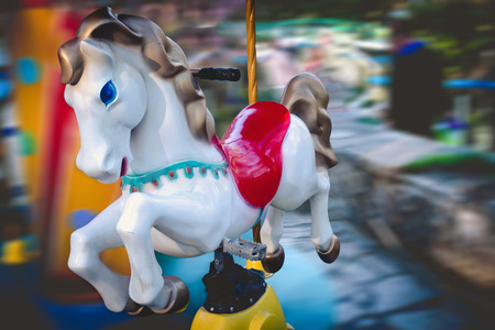play the old park: Merry-go-round horse. Carousel in a kids amusement park. Stock Photo