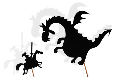 Black shadow puppets of dragon and knight and their shades on white background.
