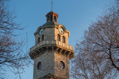 Historical building of the Old Clock Tower of Varna, Bulgaria in the evening light. Stock Photo