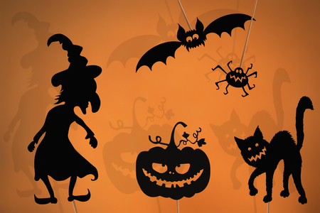 Shadow puppets of Halloween pumpkin, evil witch, spider, black cat and vampire bat.