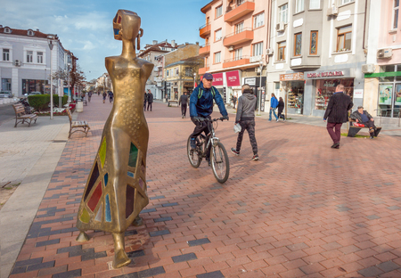 Varna, Bulgaria, April 19, 2018: A modern sculpture The Walk made of brass and stained glass by artist Veselin Kostadinov, situated in the historical center of Varna city. Editorial