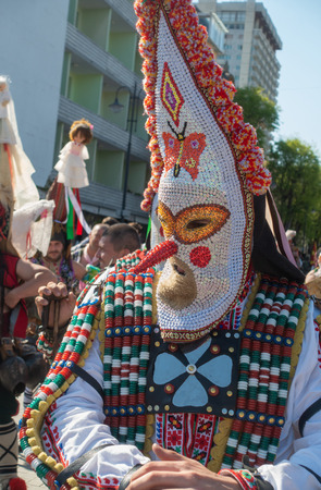 Varna, Bulgaria - April 28, 2018: Participant of the annual Varna Spring Carnival in traditional kukeri mask. Editorial
