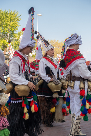 Varna, Bulgaria - April 28, 2018: Participants of the annual Varna Spring Carnival in their traditional kukeri costumes Imagens - 112424291