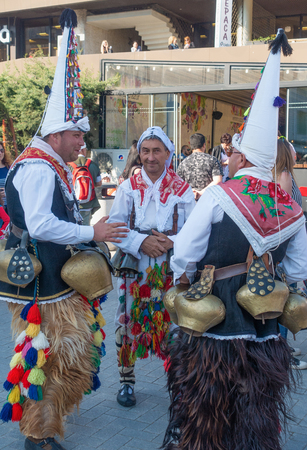 Varna, Bulgaria - April 28, 2018: Group of kukeri - costumed Balkan men who performs traditional mask dancing intended to scare away evil.
