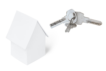 White toy house and key ring, isolated on white background.