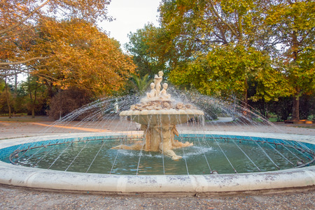 Autumn landscape with a beautiful fountain in the Sea Garden park of Varna, Bulgaria.