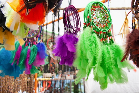 Colorful dreamcatchers at the market stand.