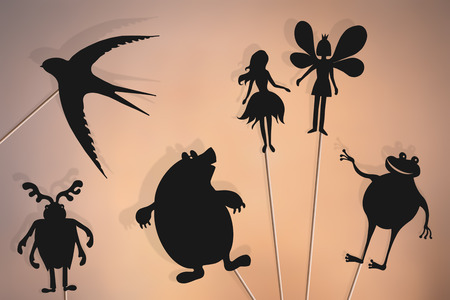 Shadow puppets of Thumbelina, flower fairy prince, swallow, mole, stag beetle (may bug) and toad. Imagens