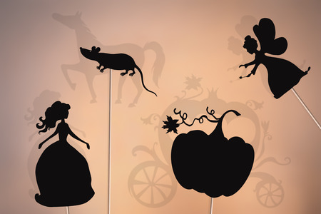 Cinderella fairy tale. Shadow puppets of Cinderella, fairy godmother, pumpkin and mouse, shadows of magic carriage and horse. Фото со стока