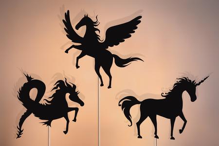 Shadow puppets of unicorn, pegasus and sea horse (hippocampus) fantastic beasts. Фото со стока