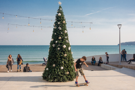 Varna, Bulgaria, March 03, 2019: Modern Christmas tree on the beach in a warm sunny day. Black Sea coast, Varna, Bulgaria.