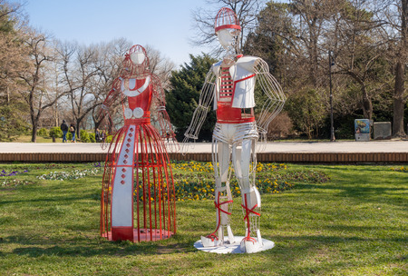 Varna, Bulgaria, March 13, 2019: Stylized figures of Pizho and Penda - Bulgarian folklore characters, symbols of spring - installed at the entrance of the pablic park Sea Garden of Varna. Редакционное