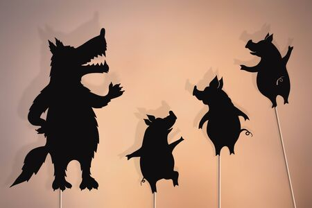 Shadow puppets of three little pigs and Big Bad Wolf. Stock Photo - 131410304